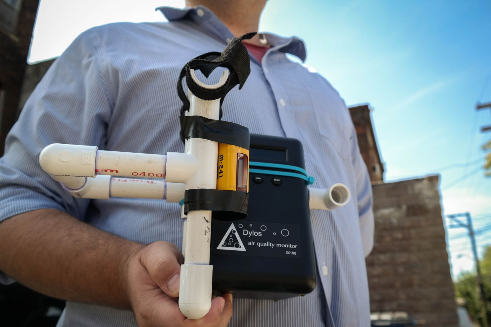 GASP's air quality monitor is a mix of high and low tech: PVC pipes, velcro and rubber cement make up a DIY bracket that holds on a sensor that measures air quality using lasers. Photo: Lou Blouin