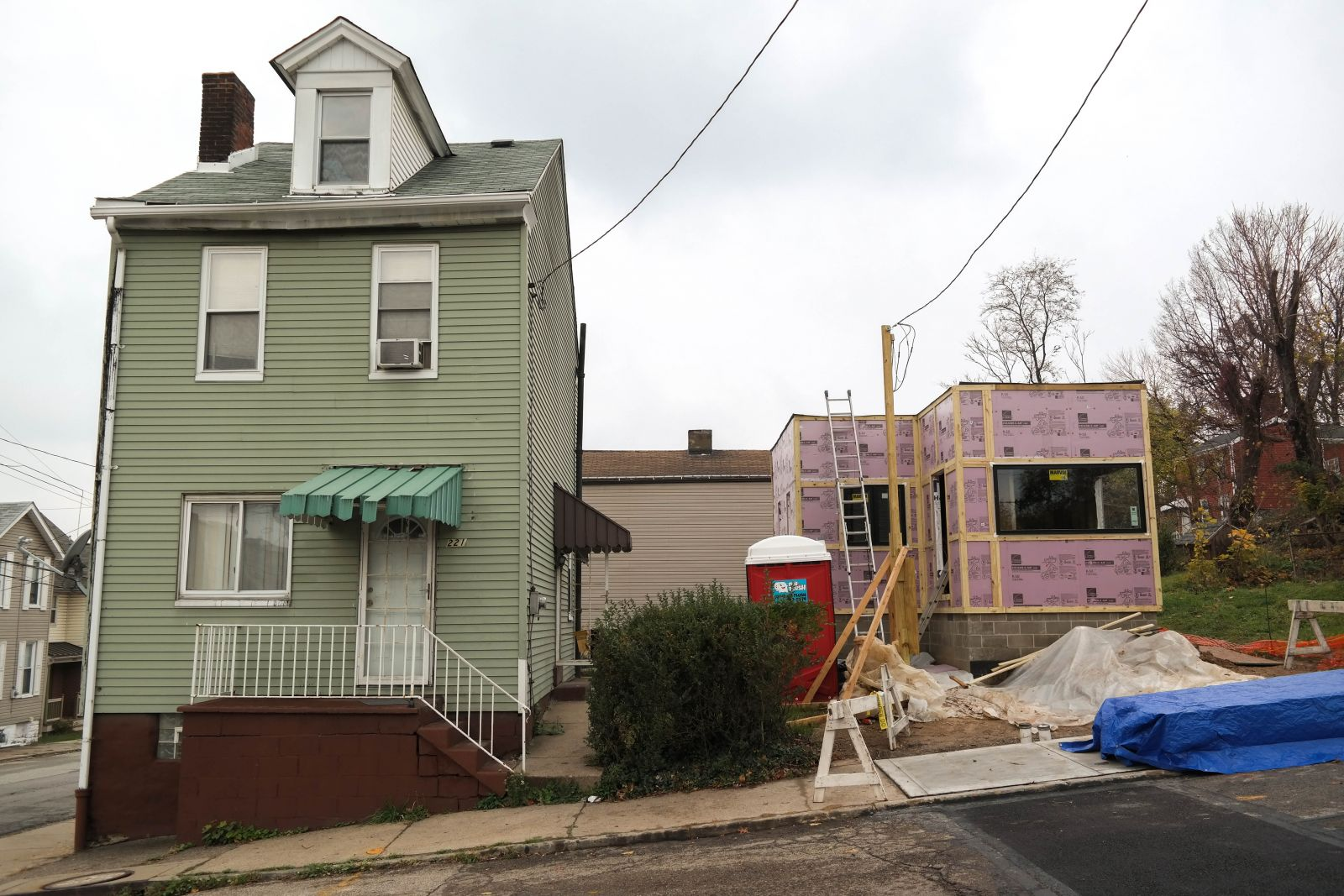 Side by side: The 330-square-foot tiny house, compared to the neighboring house on N. Atlantic Avenue. The tiny house is being built on a lot that has been vacant for years. Photo: Lou Blouin